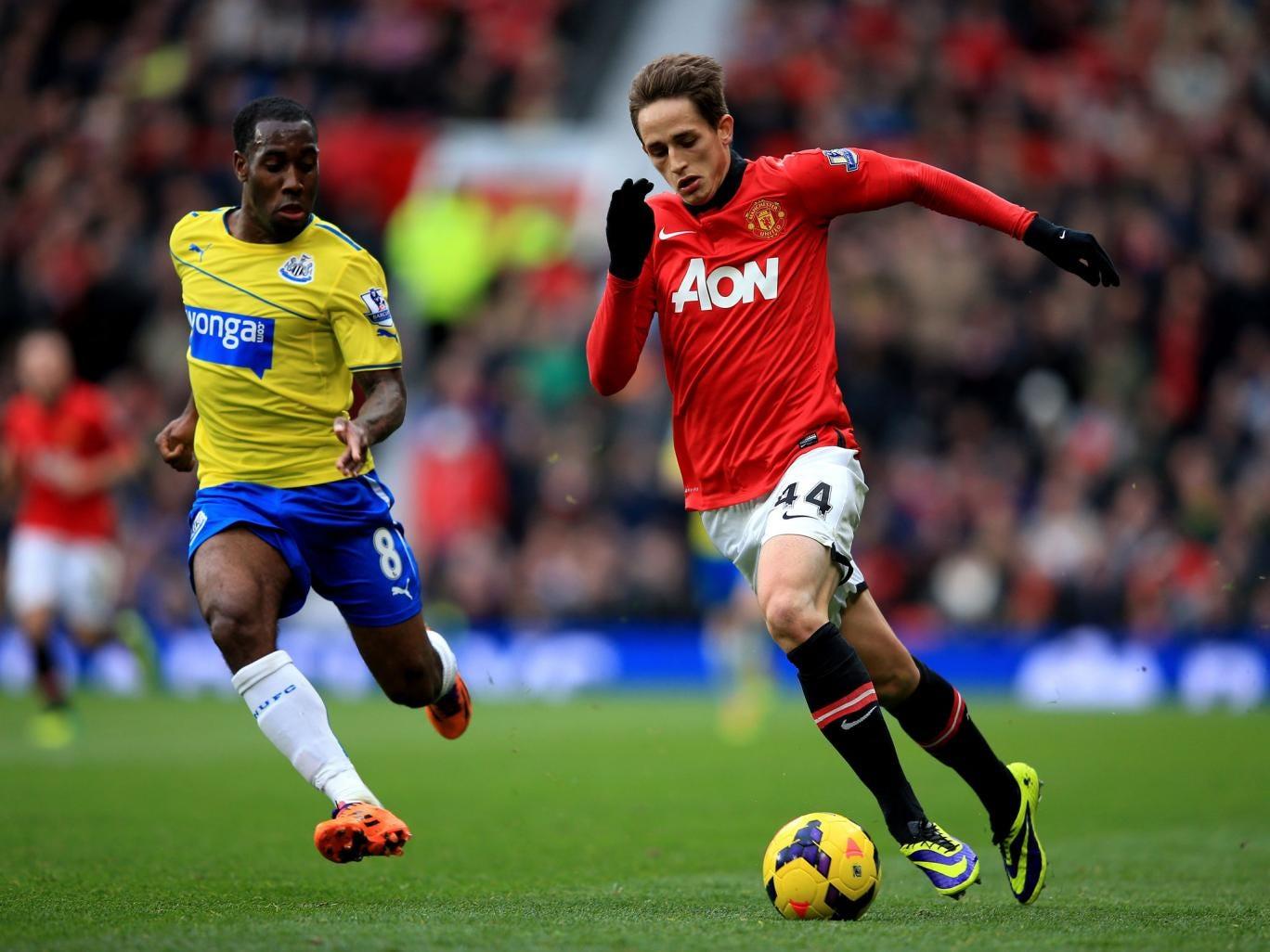 Adnan Januzaj of Manchester United is pursued by Vurnon Anita of Newcastle