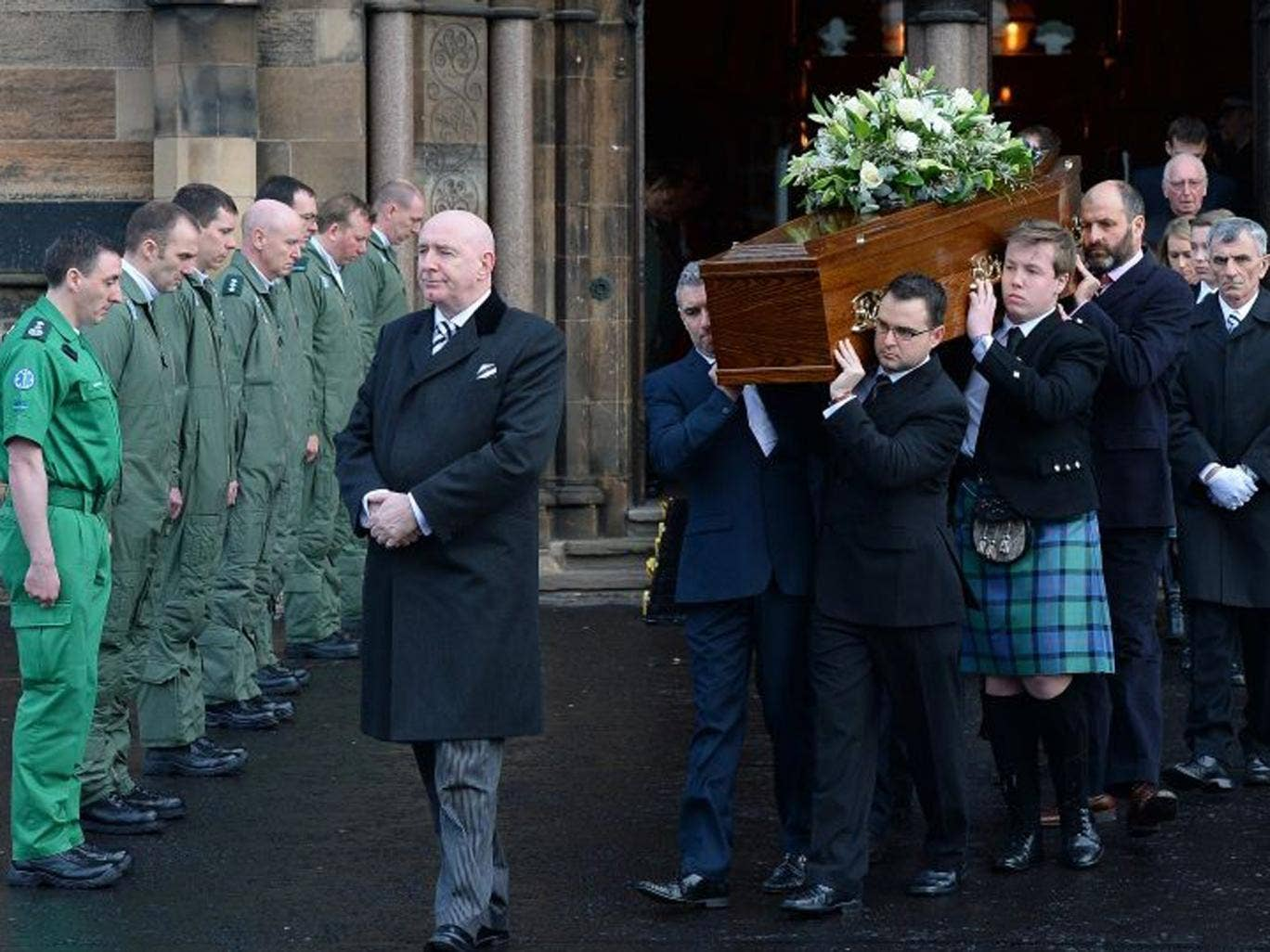 The body of David Traill is carried from the funeral service at the University of Glasgow's Bute Hall