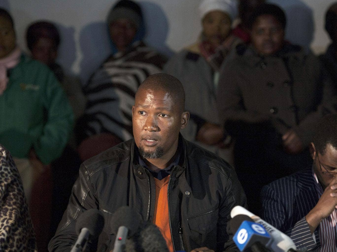 Tangled lives: Mandla Mandela speaking at a press conference on his his grandfather's health earlier in the year