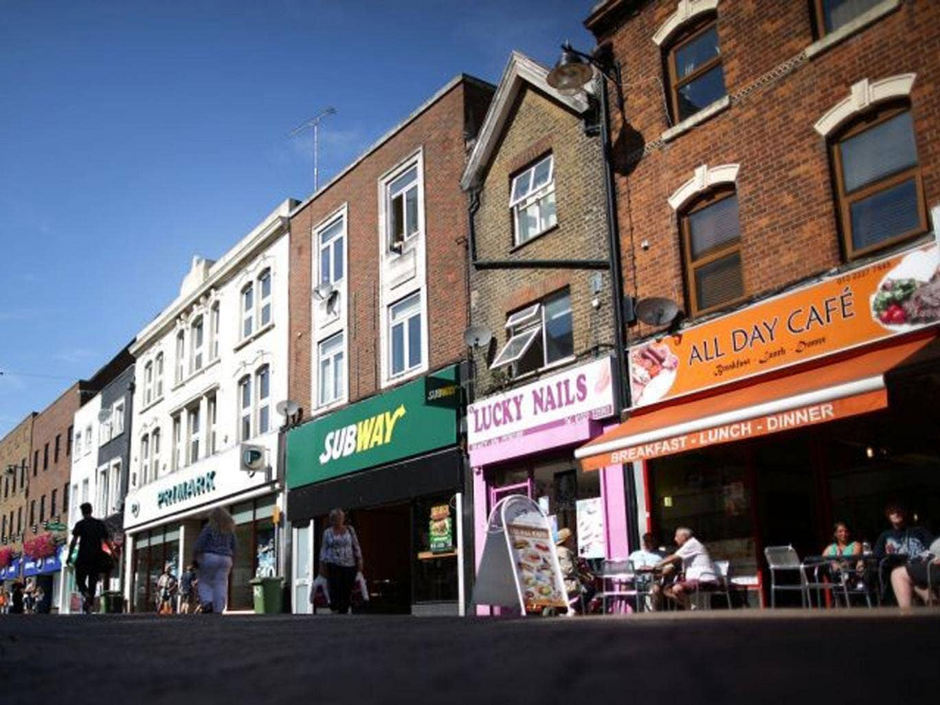 The low road: Small shops in town centres such as Dartford, Kent, are struggling