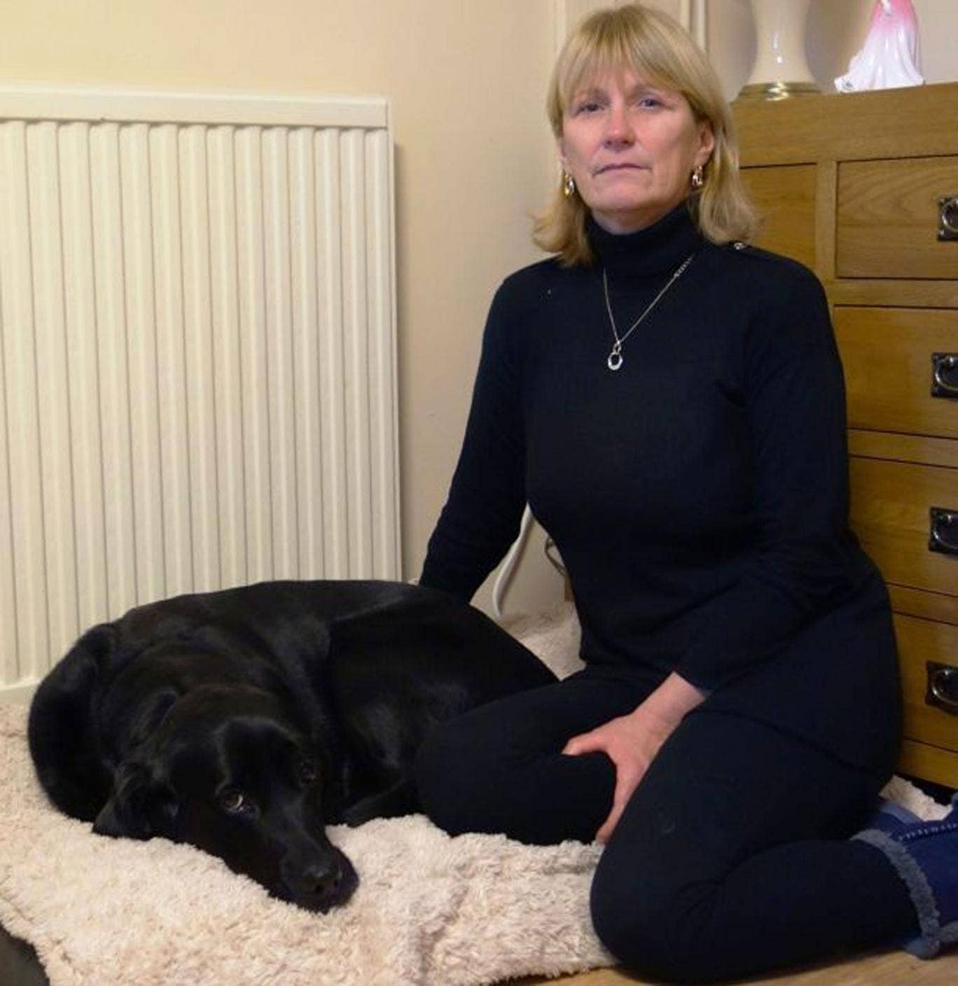 Julie Rees and her guide dog, Gwen, after the animal was brutally attacked and injured just yards from her home in Fforestfach, Swansea