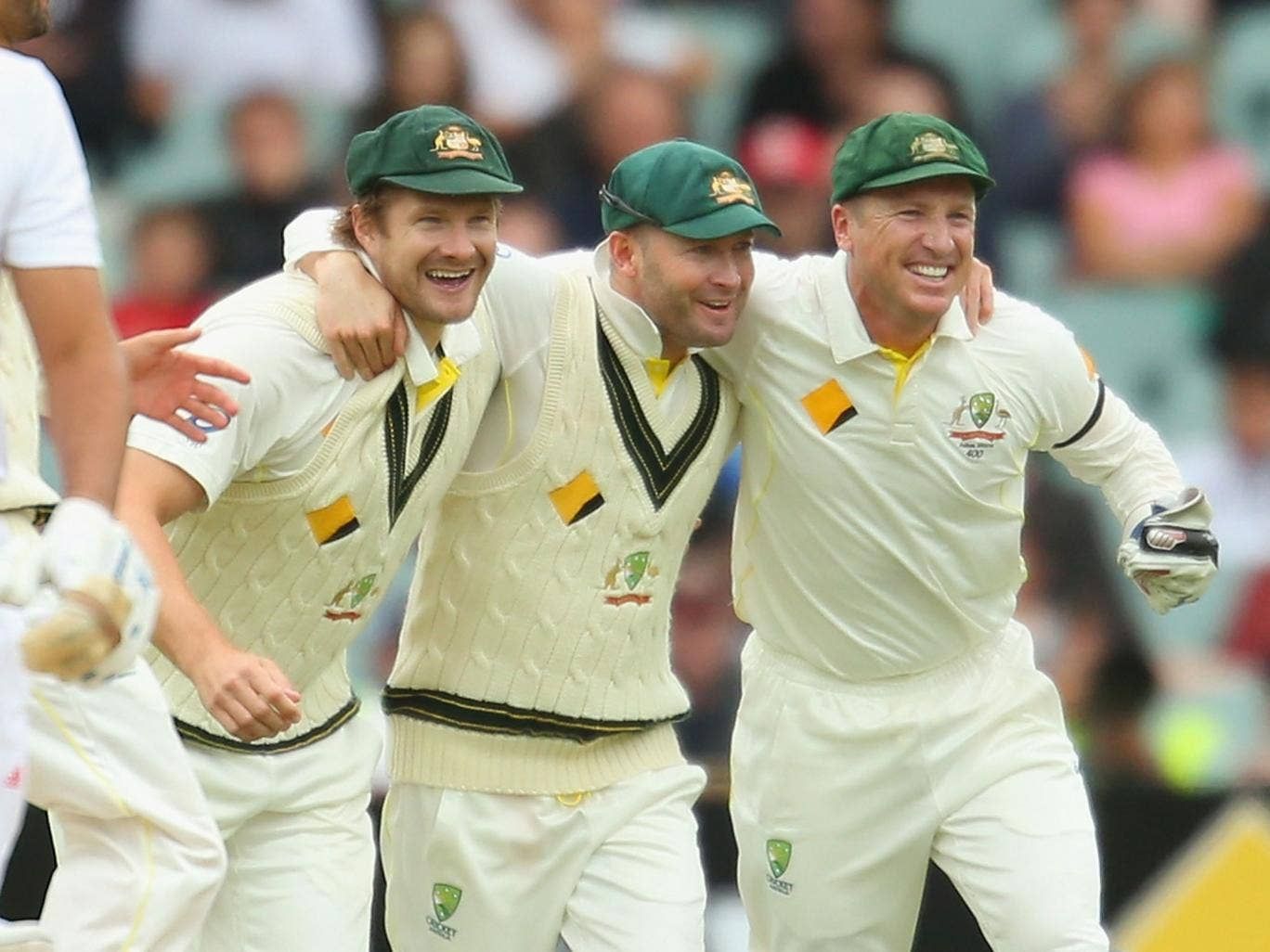 Australia captain Michael Clarke (C) celebrates with Shane Watson (L) and Brad Haddin (R) after victory over England in the Ashes Second Test