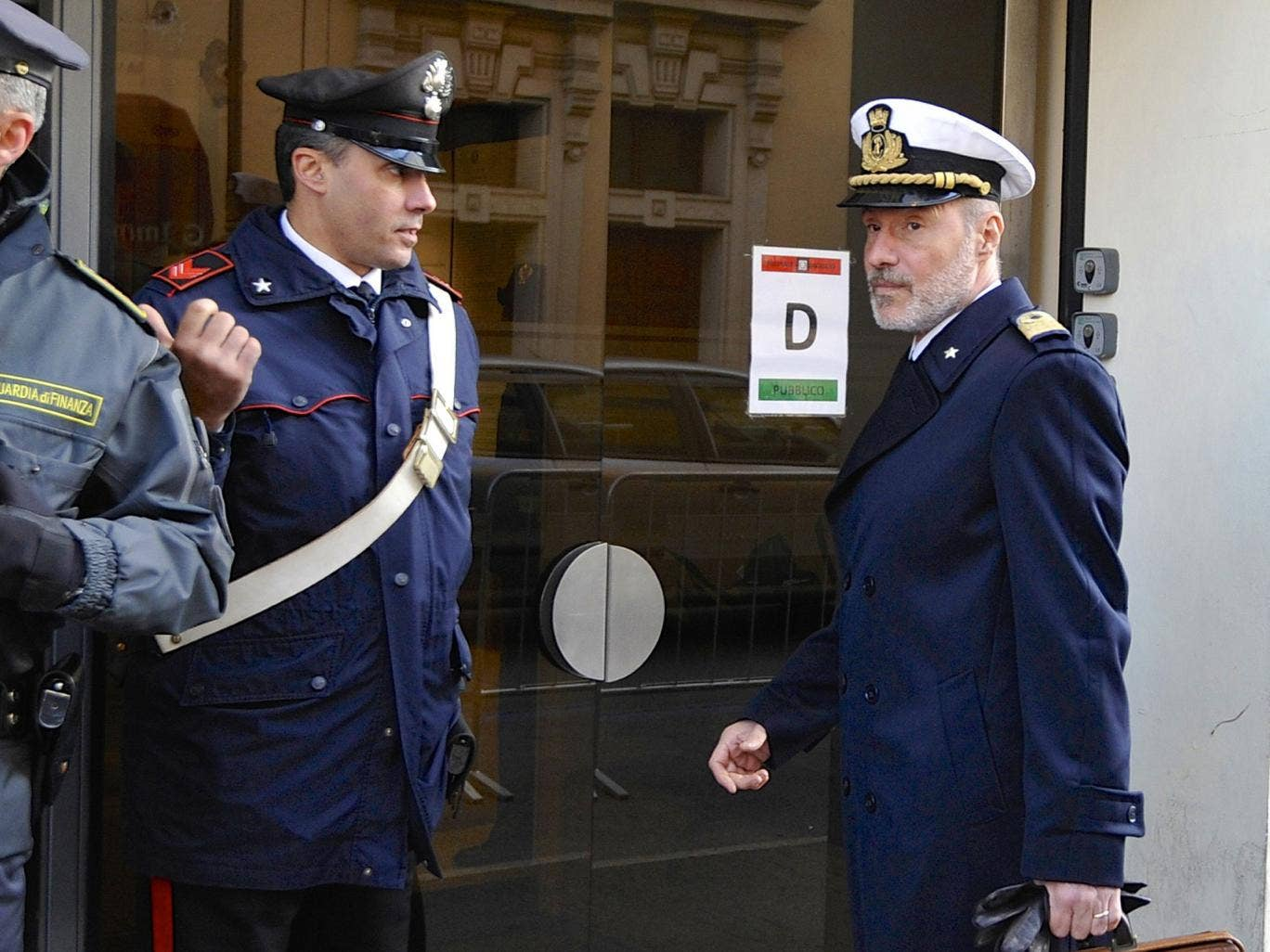 Coast Guard Captain Gregorio De Falco, right, arrives at the Grosseto court - the court was told hundreds of people were still aboard the shipwrecked Costa Concordia when the commander abandoned the cruise liner in a lifeboat