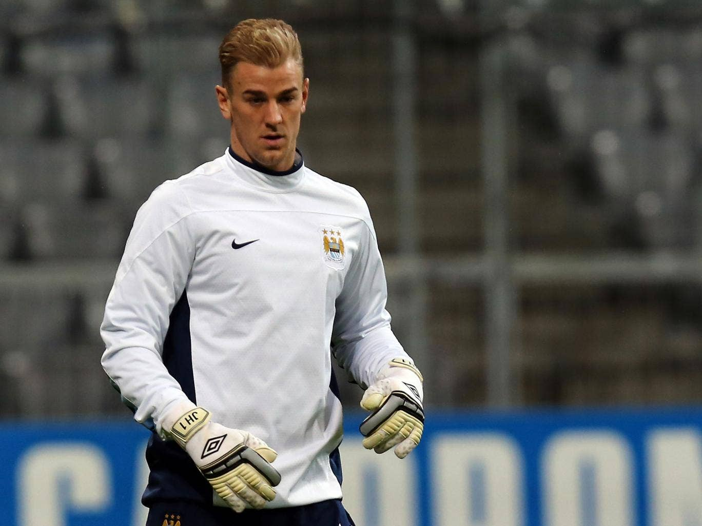 Goalkeeper Joe Hart plays the ball during a Manchester City training session at Allianz Arena