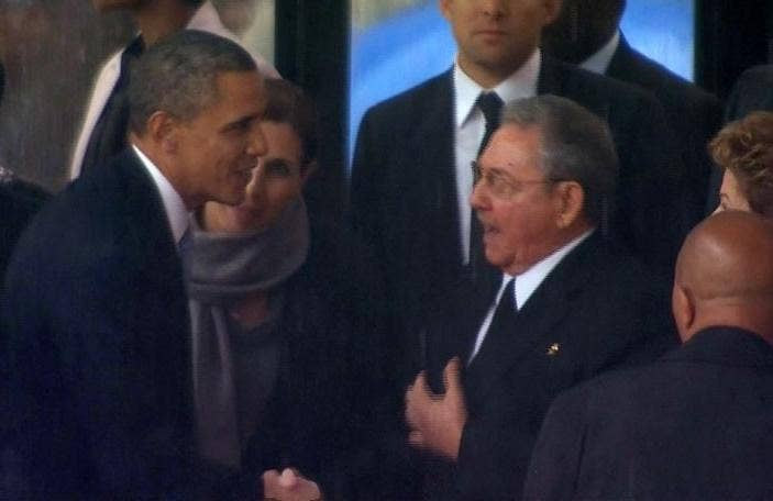 In this image from TV, US President Barack Obama shakes hands with Cuban President Raul Castro at the FNB Stadium in Soweto, South Africa, at the memorial service for former South African President Nelson Mandela