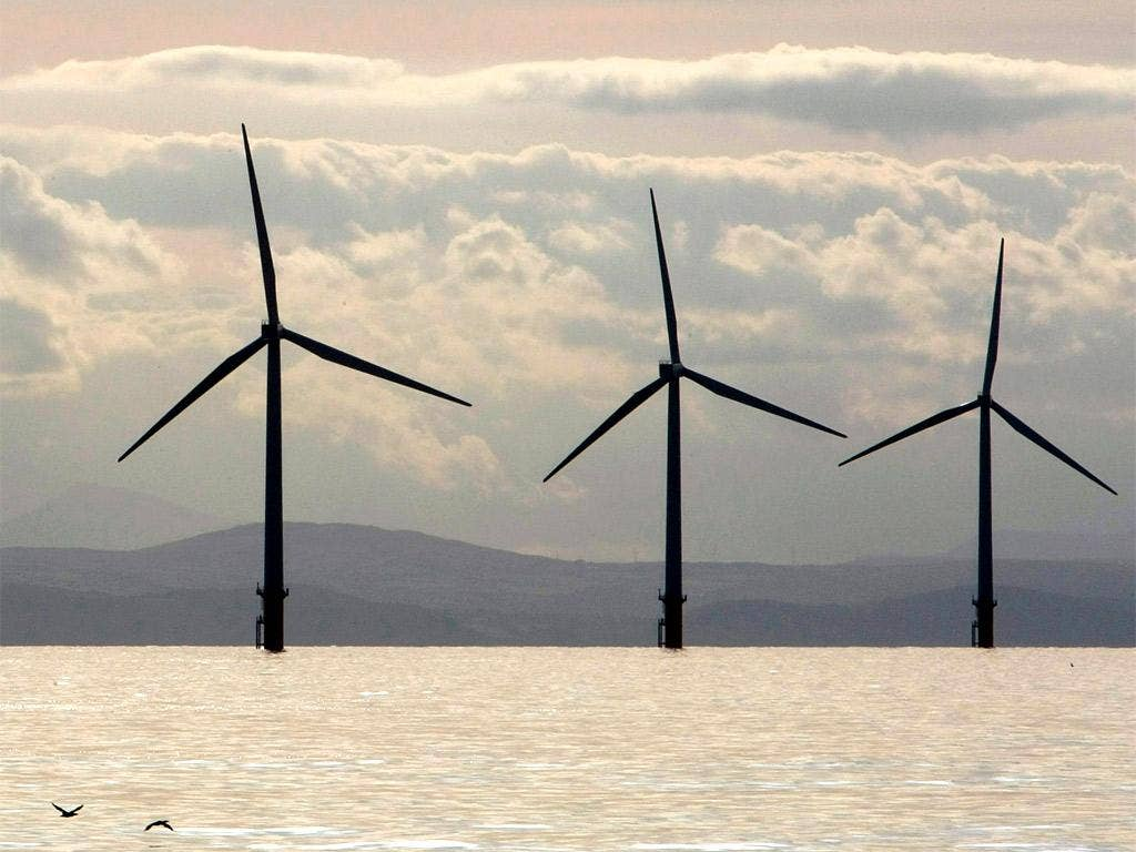 Turbines of the Burbo Bank off shore wind farm adorn the skyline in the mouth of the River Mersey