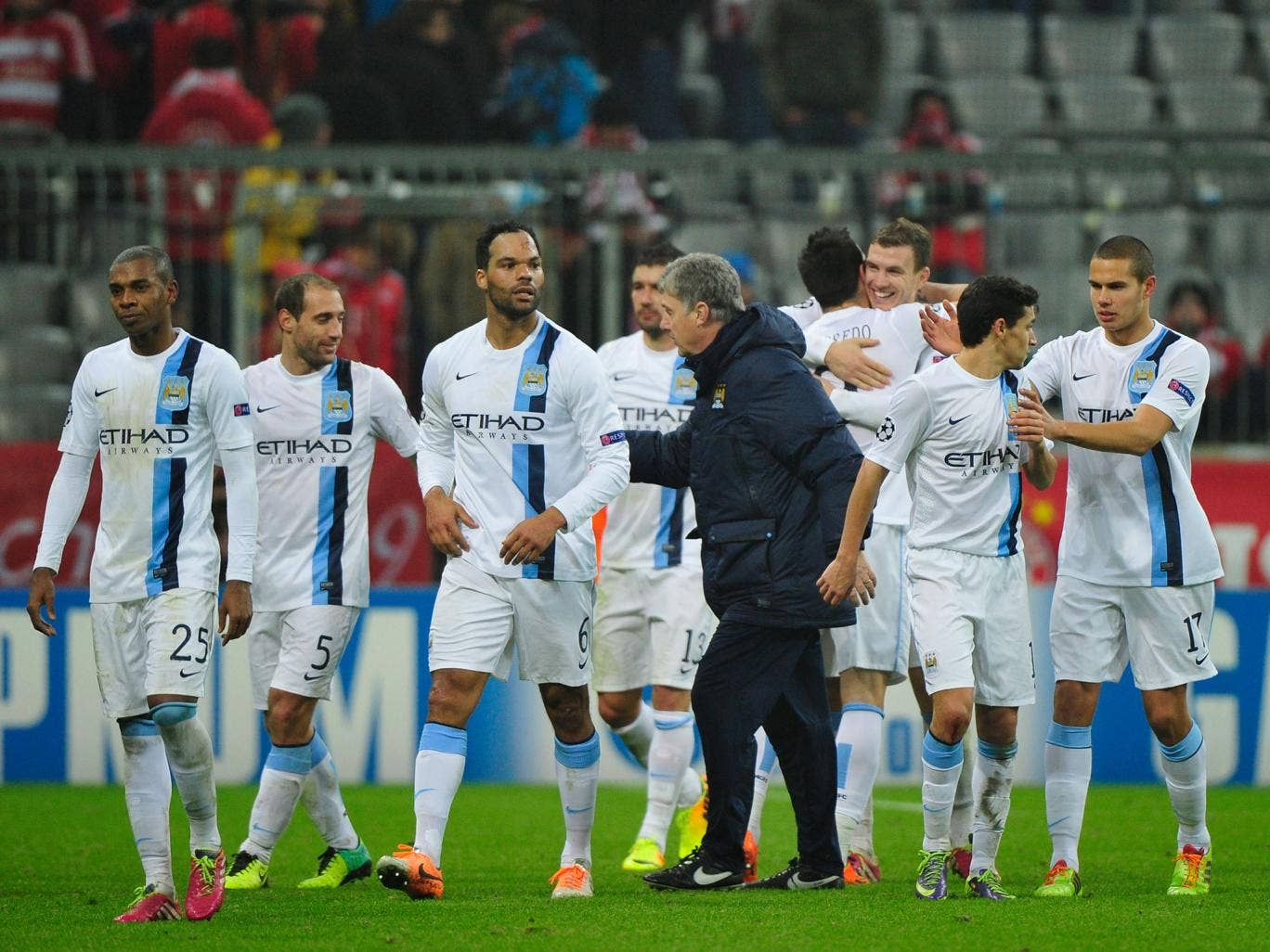 Manchester City manager Manuel Pelegrini congratulates his players after their successful 3-2 victory over Champions League holders Bayern Munich