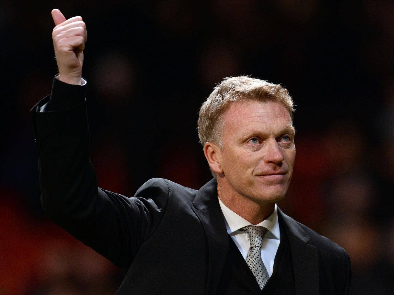 Manchester United manager David Moyes salutes the home fans after their Champions League victory over Shakhtar Donetsk
