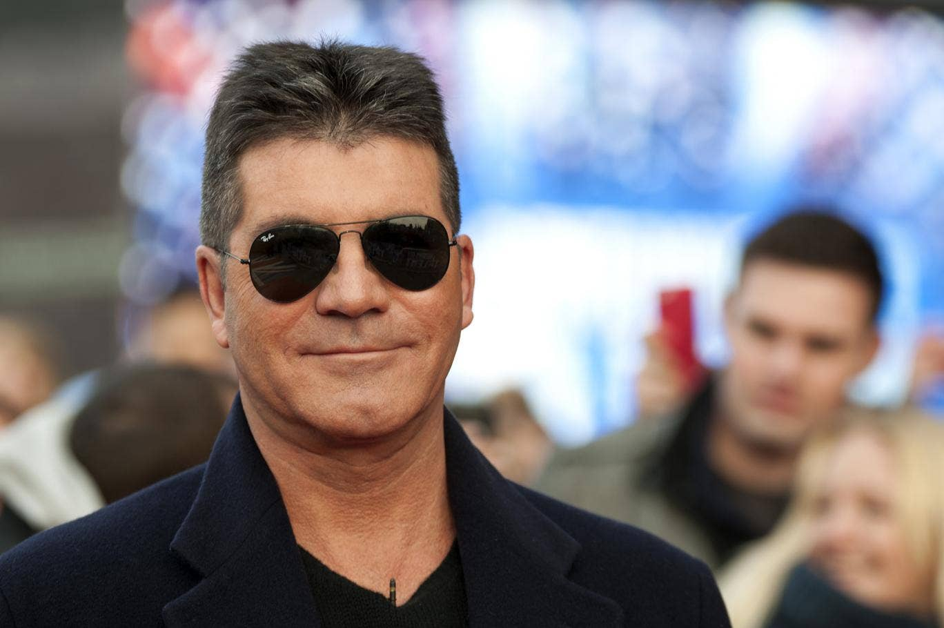 Look who's back: Simon Cowell will sit on the UK's X Factor judging panel this year
