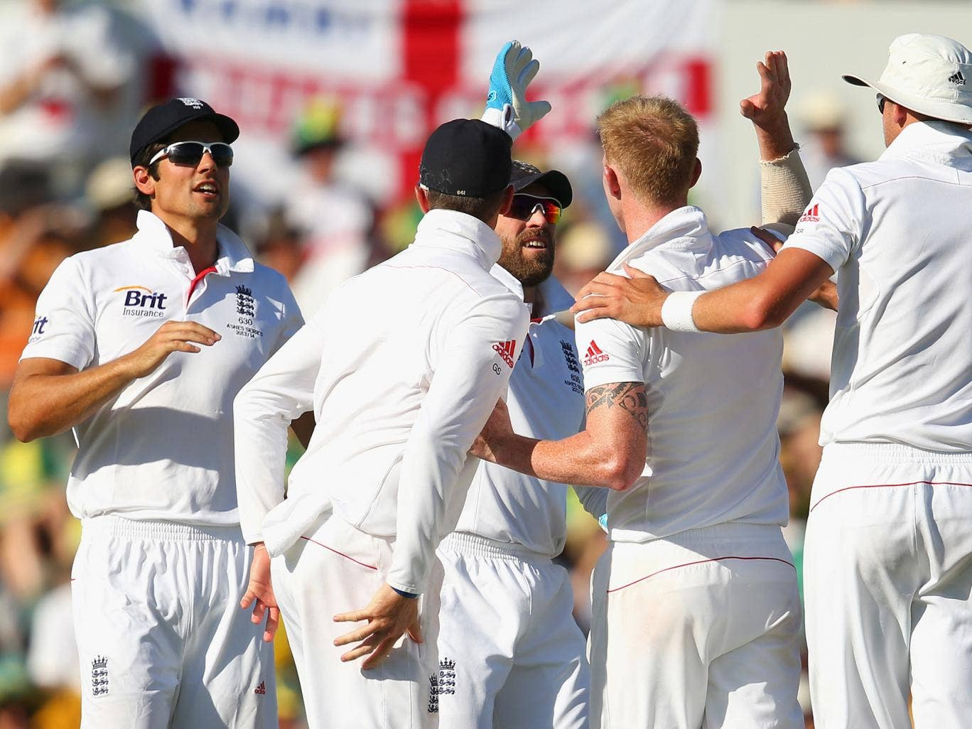 England celebrate the wicket of Brad Haddin but not before he had made 55