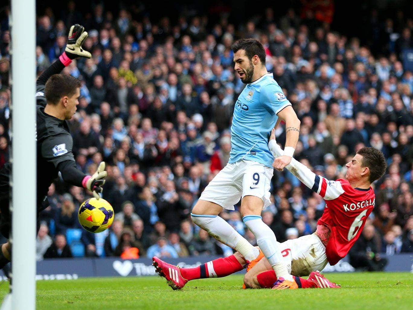 Laurent Koscielny suffered a 'deep laceration to the knee' in this collision with Alvaro Negredo
