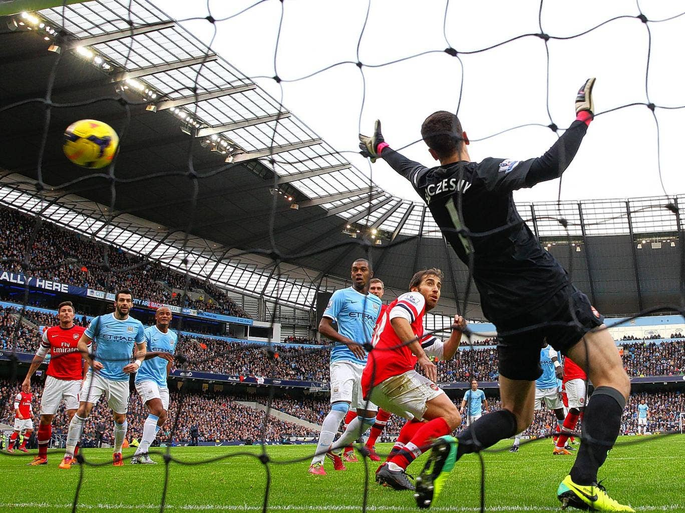 Sergio Aguero (not pictured) puts Manchester City ahead witht he opening goal against Arsenal