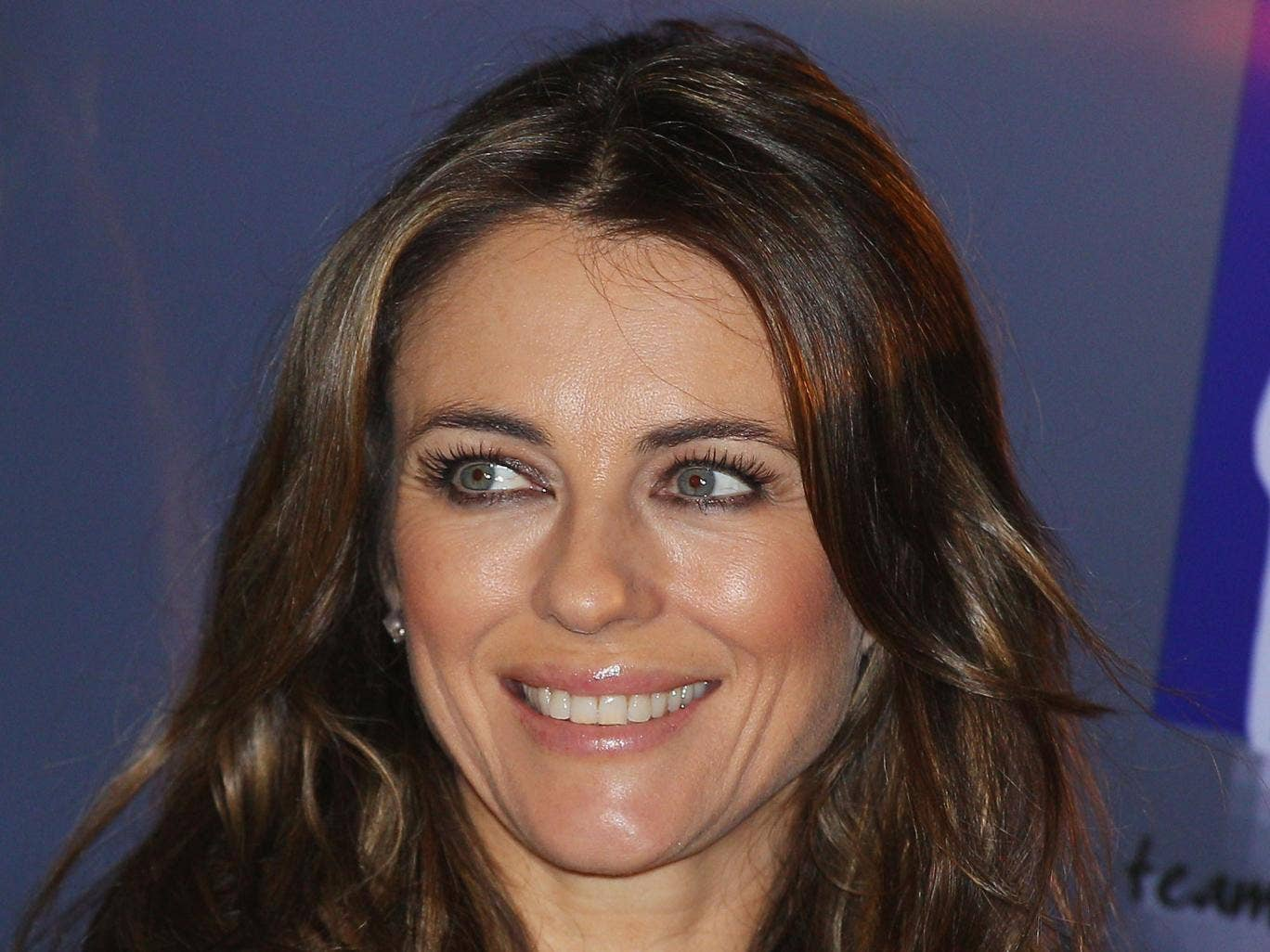 Liz Hurley is selling her shows for charity