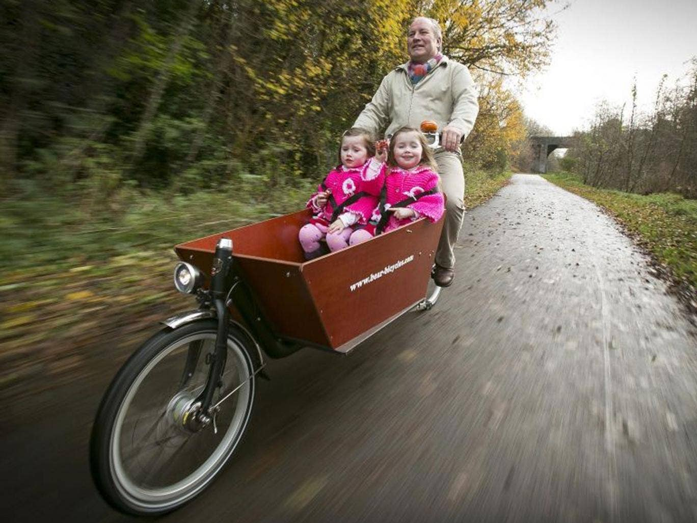 Going Dutch: Steven Patterson regularly takes his three-year-old twin daughter Lilly and Grace for spins on his cargo bike