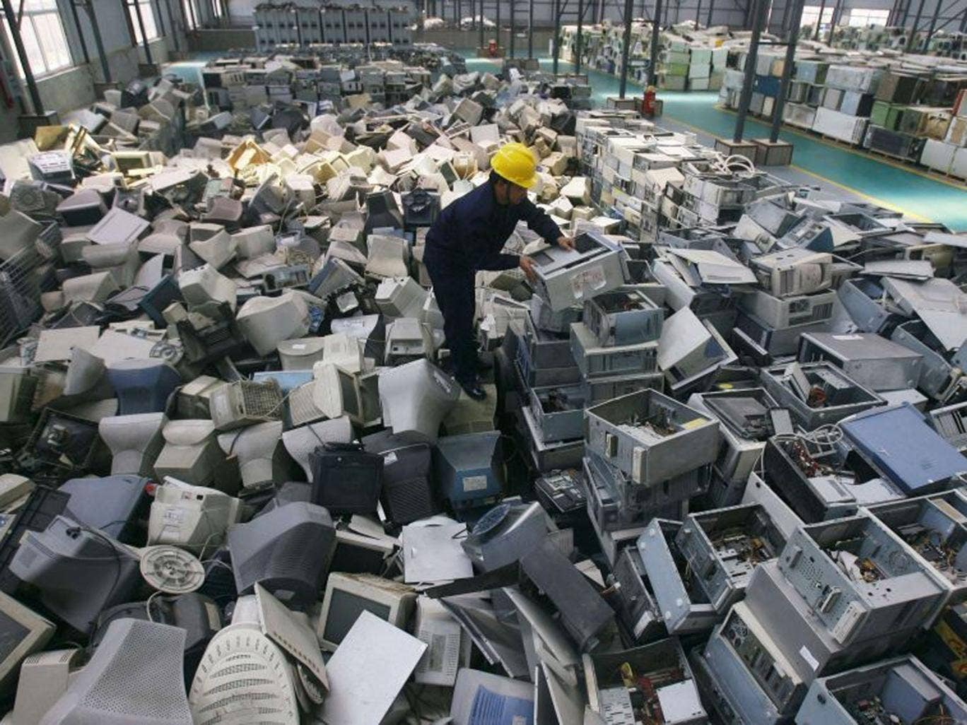 West's exports: Old computers wait to be recycled in China