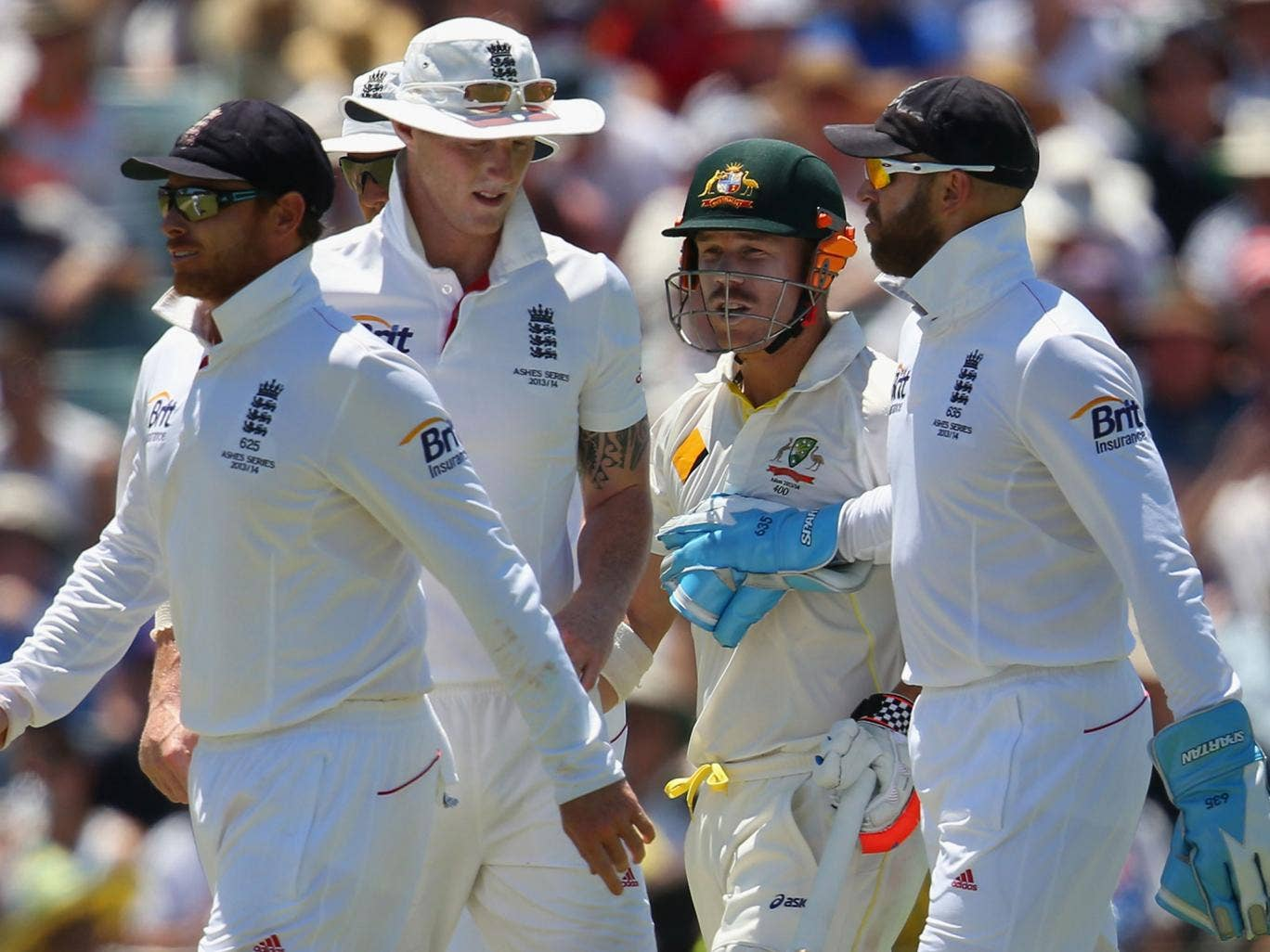 Matt Prior (far right) engages in a war of words with Australian batsman David Warner (second from right)