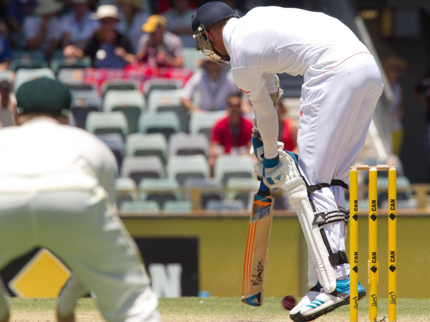 Stuart Broad is hit on the foot by a Mitchell Johnson full-toss delivery