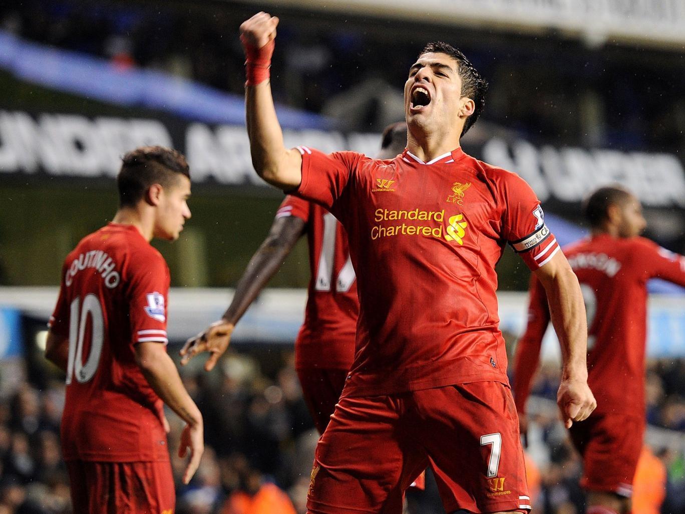 Liverpool striker Luis Suarez celebrates after scoring against Tottenham