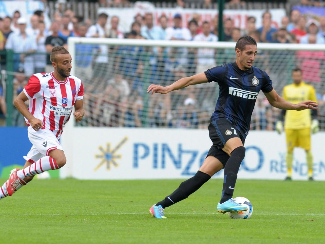 Ishak Belfodil (R) of Internazionale Milano