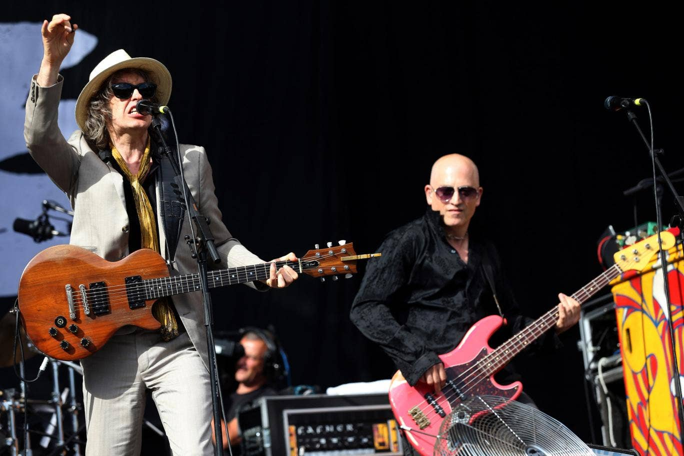 Mike Scott, singer of British band 'The Waterboys' and violinist Steve Wickham (L) perform on stage