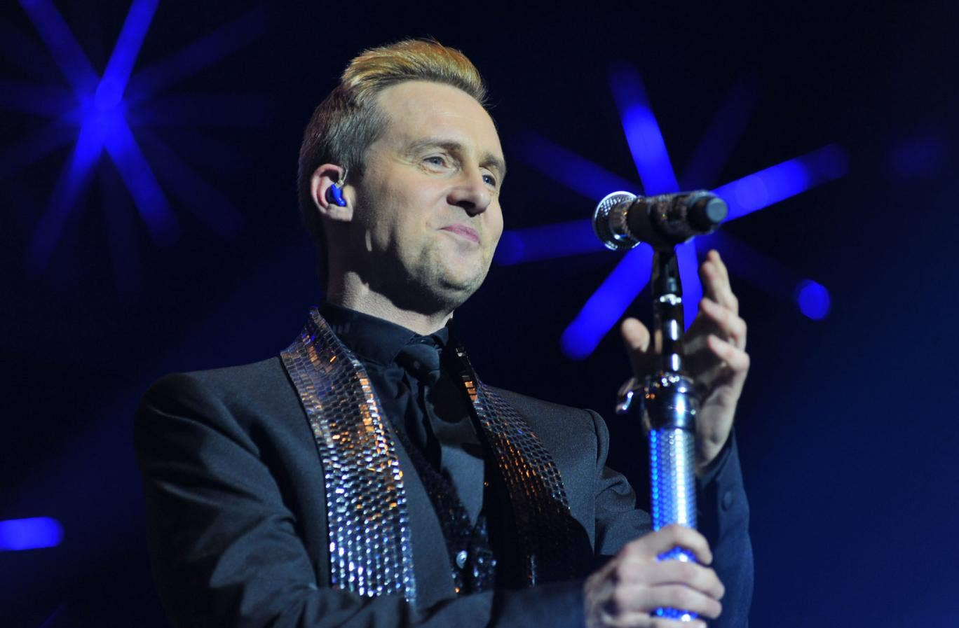 Former Steps singer Ian 'H' Watkins received a full apology in open court for his image being used to illustrate a story about convicted paedophile Ian Watkins from the Lostprophets.