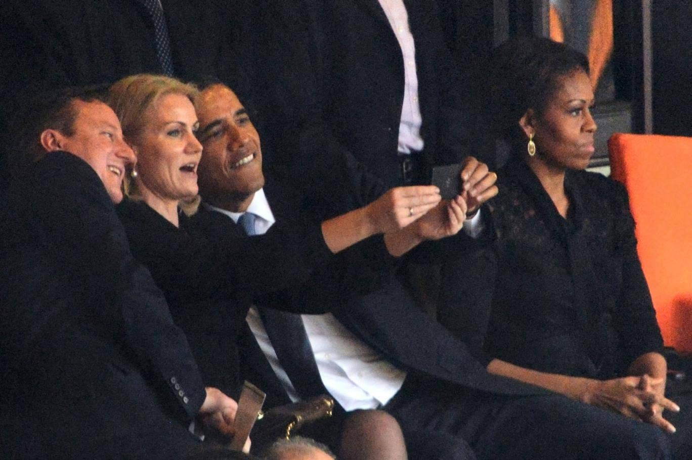 Obama and Cameron cosy up for selfie with Danish PM at Nelson Mandela's memorial service