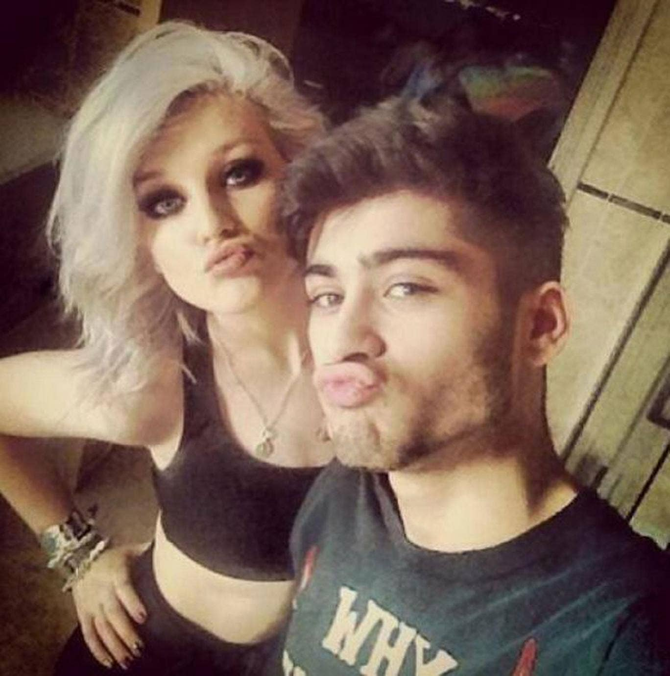 Zayn and Perrie in their selfie making full-on duck faces, kissy smooches as they pose next to each other