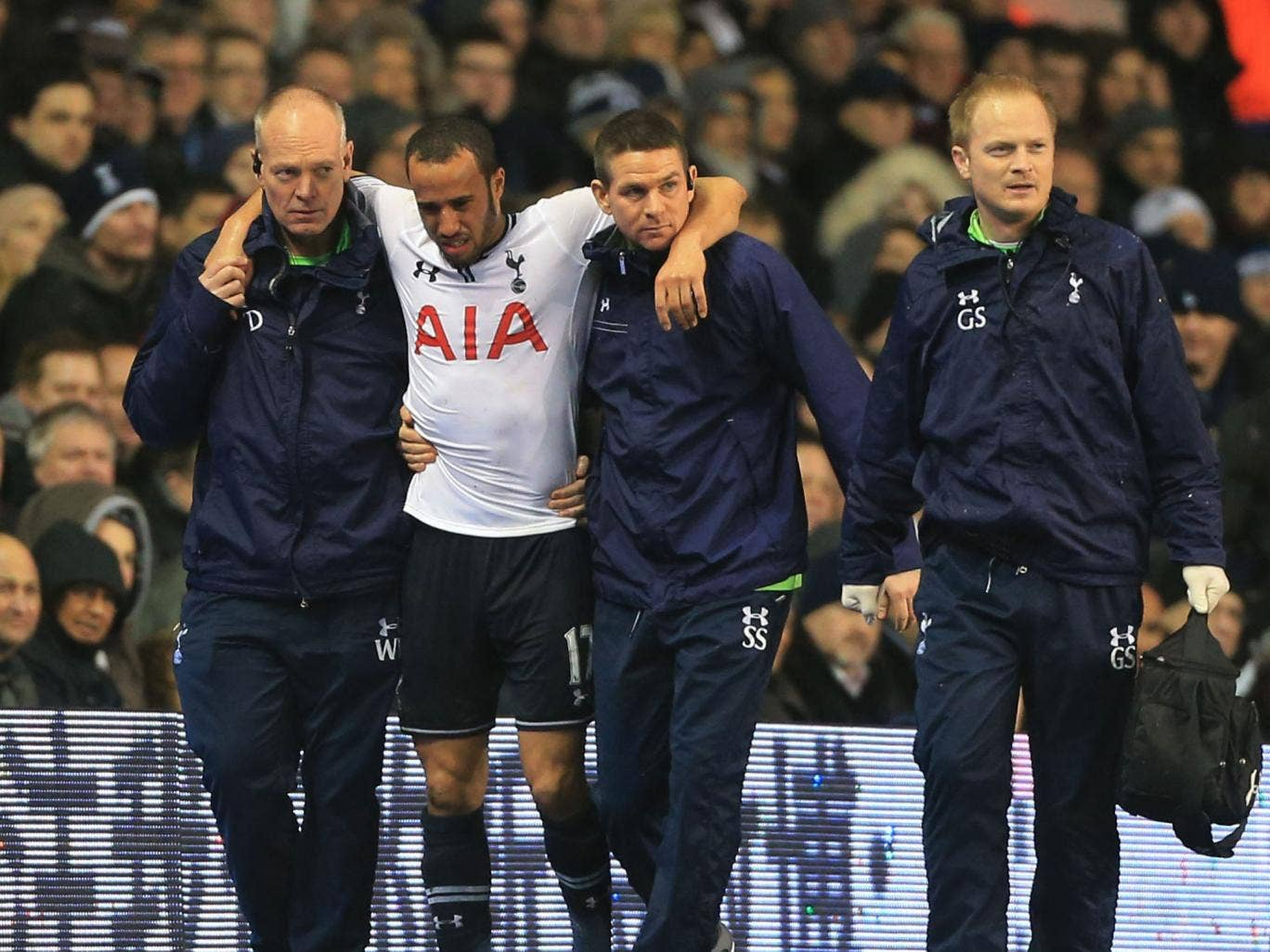 Andros Townsend is helped from the White Hart Lane pitch but his injury is not as bad as first feared