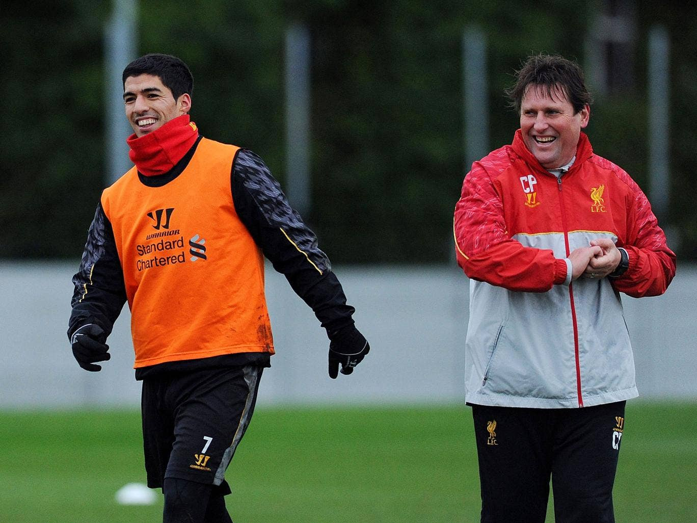 Luis Suarez laughing with Colin Pascoe during training