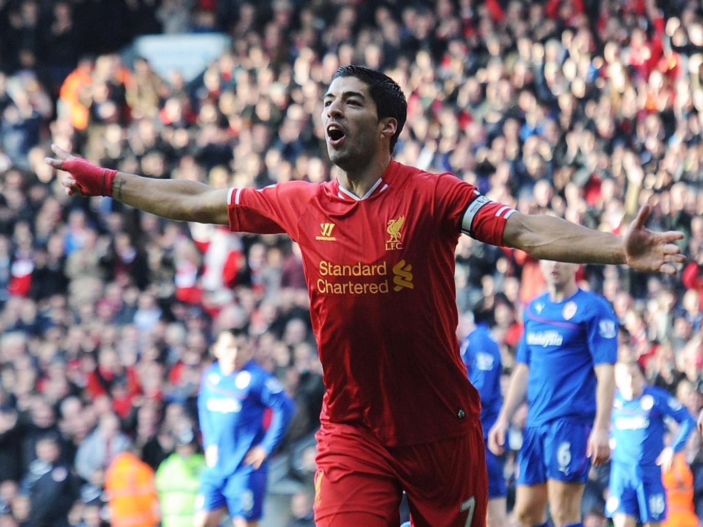Luis Suarez celebrates after scoring for Liverpool against Cardiff City
