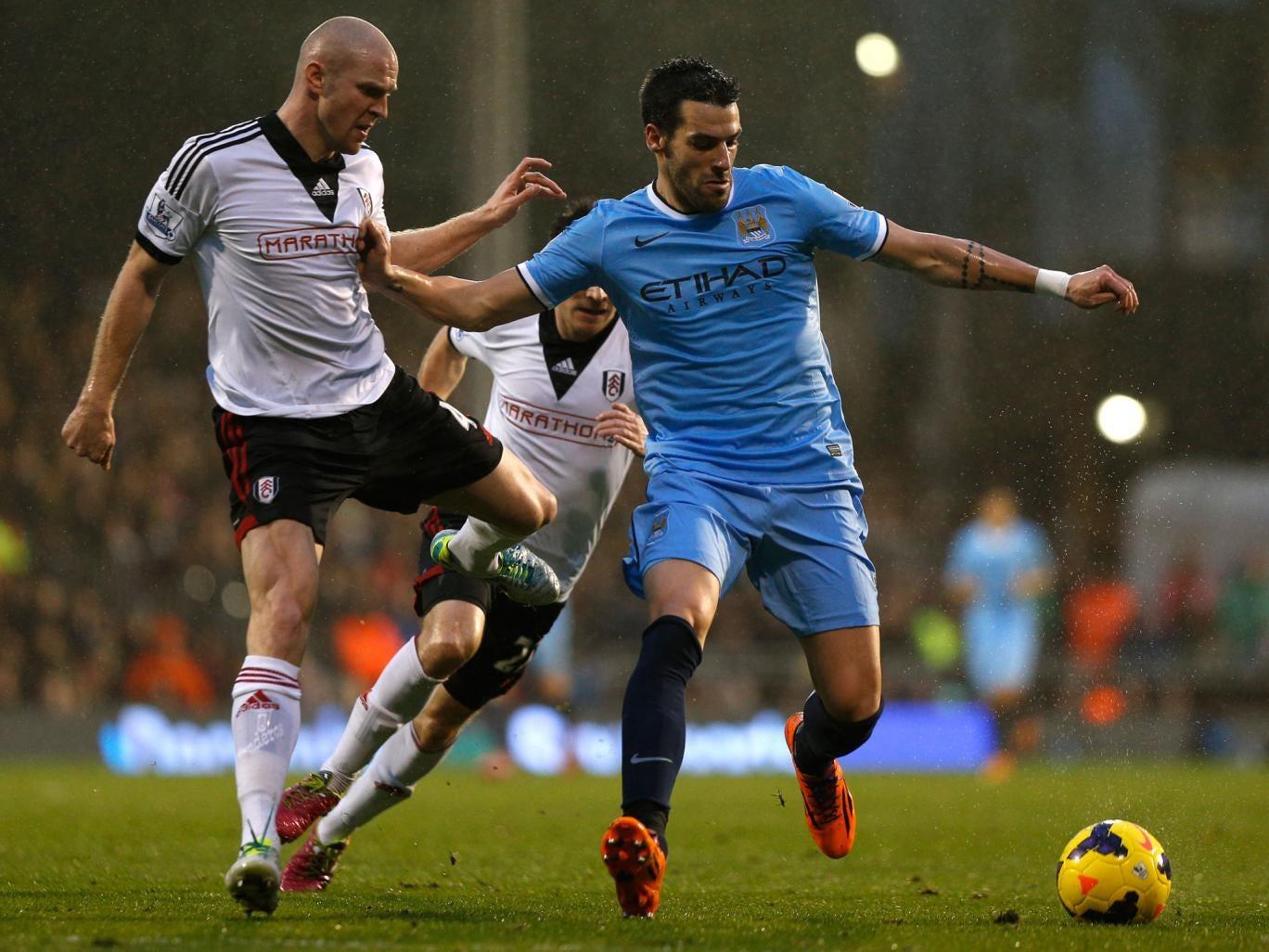 Alvaro Negredo (R) tries to hold off Fulham's Swiss defender Philippe Senderos