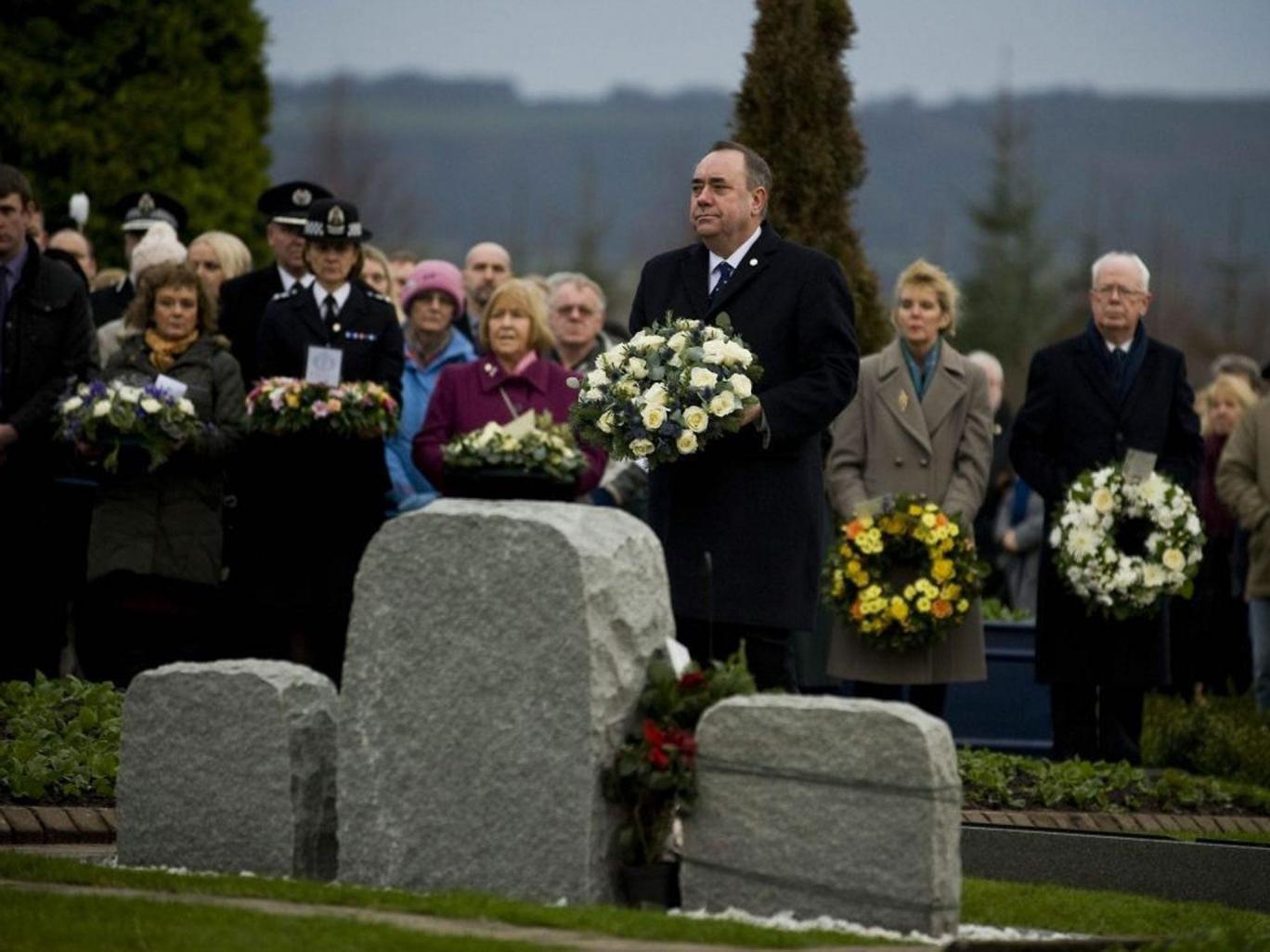 Scotland's First Minister, Alex Salmond, lays a wreath at Dryfesdale Cemetery, near Lockerbie