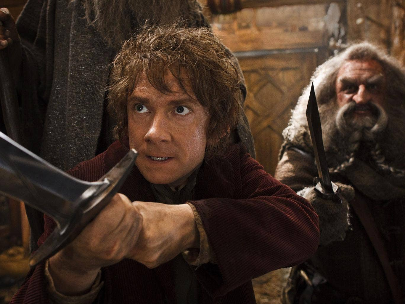 According to studio estimates Sunday, Peter Jackson's 'Hobbit' sequel took in $31.5 million in its second weekend of release. That topped Will Ferrell's 'Anchorman' sequel, which nevertheless opened strongly in second place