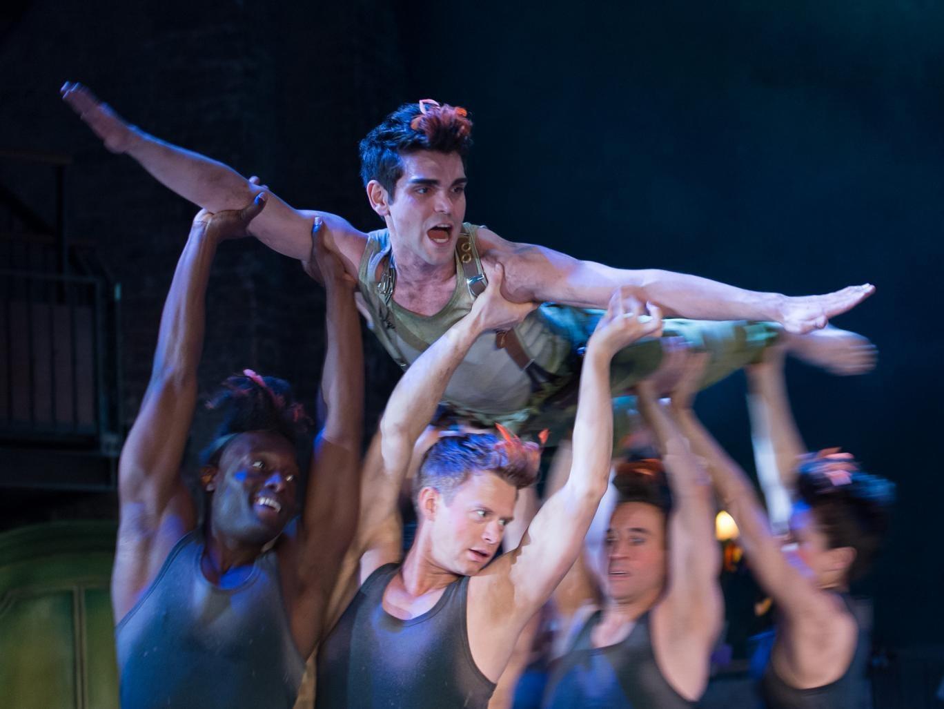 Sam Swann as Peter Pan, held by the Shadows