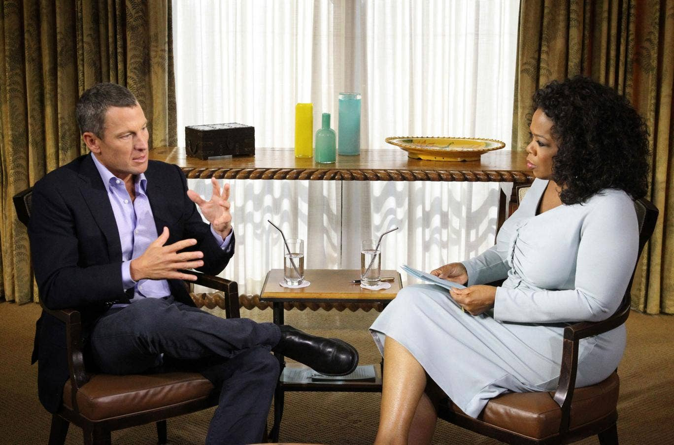 Oprah Winfrey speaks with Lance Armstrong during an interview regarding the controversy surrounding his cycling career