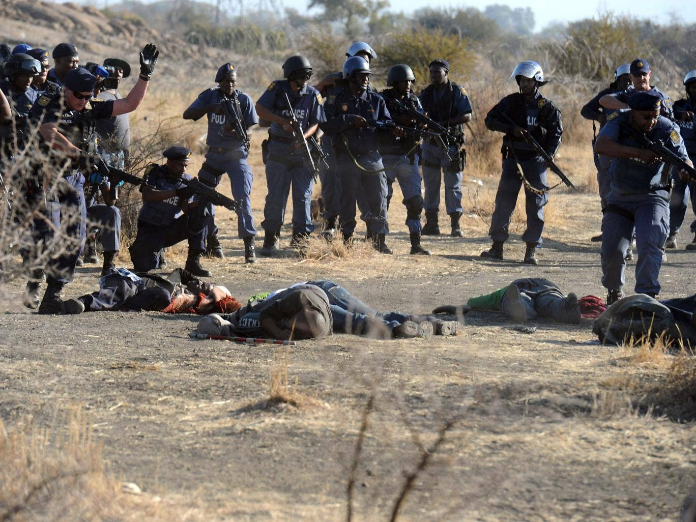 Police surround fallen miners after violent clashes near a platinum mine in Marikana in August last year. A commission of inquiry has said it feels it may not be being told the truth