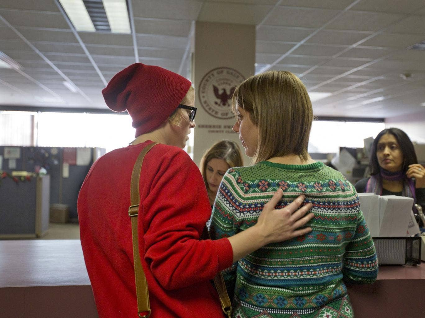 Samantha Christensen, left, and Elise Larsen apply for a marriage license in the Salt Lake County Clerk's Office. On Friday, Utah became the 18th state in the nation to allow gay marriage, however the state is seeking an urgent appeal