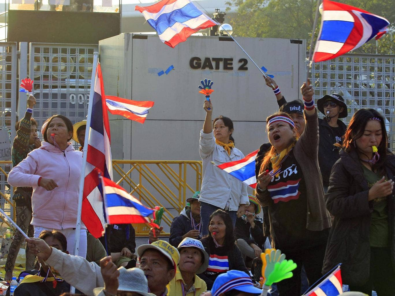 Thai anti-government protesters gather in front of a registration venue for election candidates at the Thai-Japan Stadium in Bangkok,