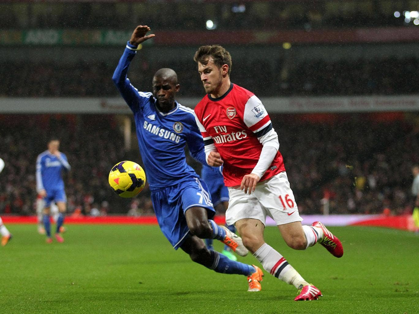 Arsenal's Aaron Ramsey tangles with Chelsea's Ramires during the draw at the Emirates