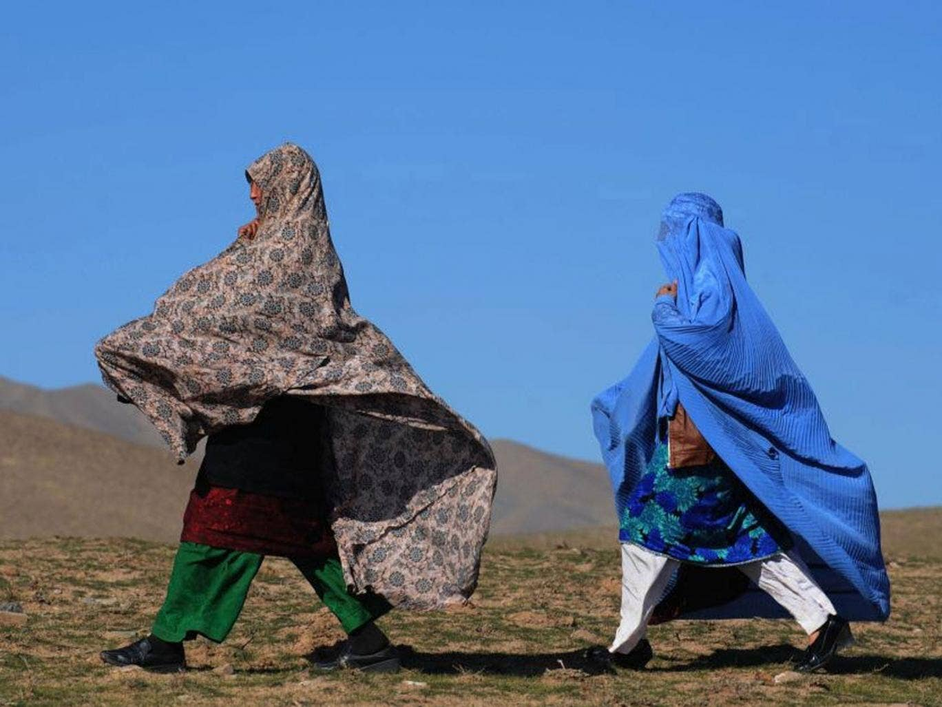 Afghan residents walk to receive winter blankets during a relief distribution programme in Herat. Decades of conflict have left Afghanistan with one of the highest internally displaced populations in the world