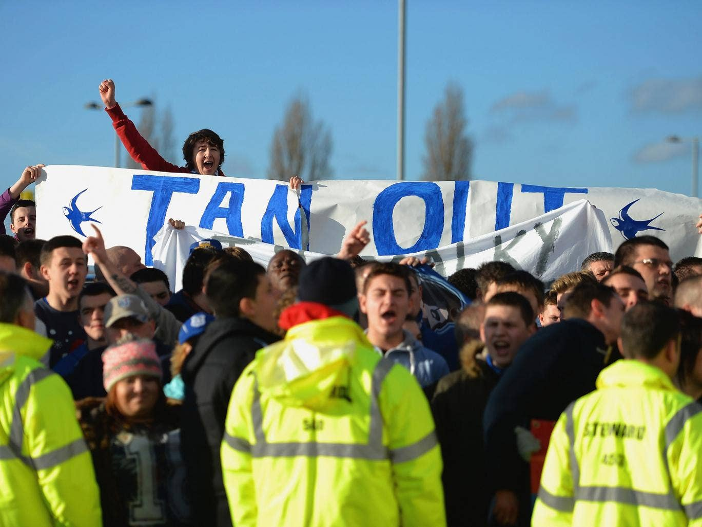 Cardiff City fans protest against club owner Vincent Tan following the furore surrounding the future of manager Malky Mackay