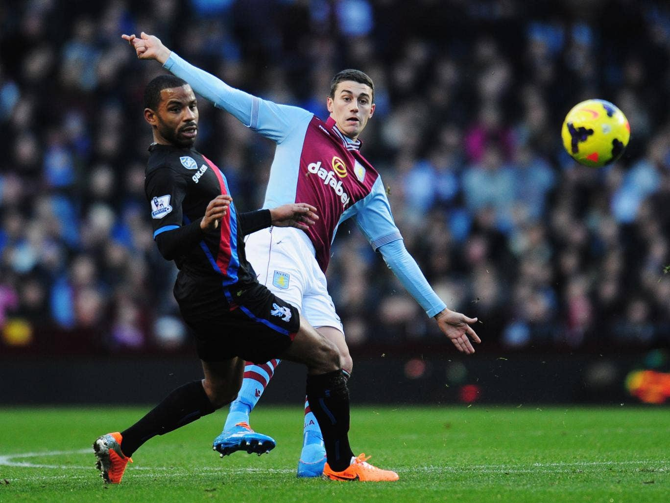 Jason Puncheon (L) and Matthew Lowton (R) compete for the ball during the match between Aston Villa and Crystal Palace