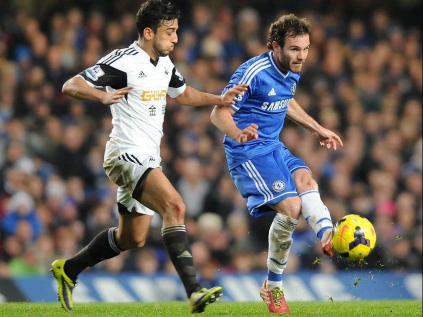 Chelsea's Spanish midfielder Juan Mata vies with Swansea City's Welsh defender Neil Taylor (AFP)