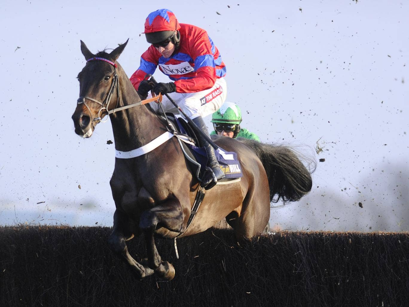 Barry Geraghty aboard Sprinter Sacre before he was pulled up after the seventh of the Desert Orchid Chase at Kempton