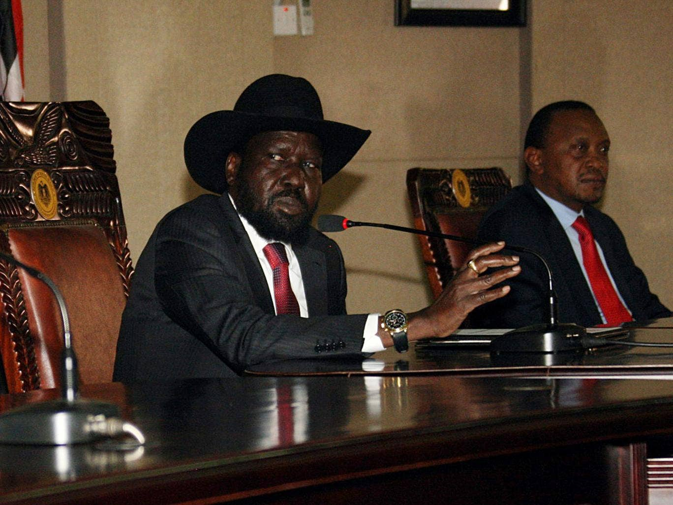 South Sudan President, Salva Kiir, left, sitting with his Kenyan counterpart Uhuru Kenyatta - South Sudan's neighbours threw their weight behind President Salva Kiir, saying they would not accept any bid to overthrow hisdemocratically elected government