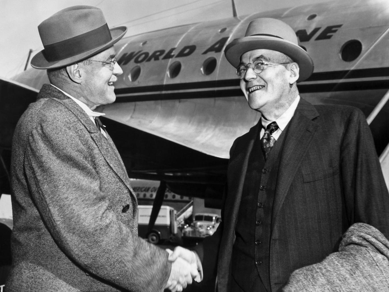 John Foster Dulles greets his brother Alan at the airport