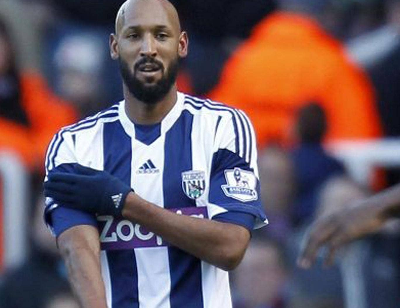 West Brom striker Nicolas Anelka makes an alleged anti-Semitic gesture when celebrating his first goal against West Ham