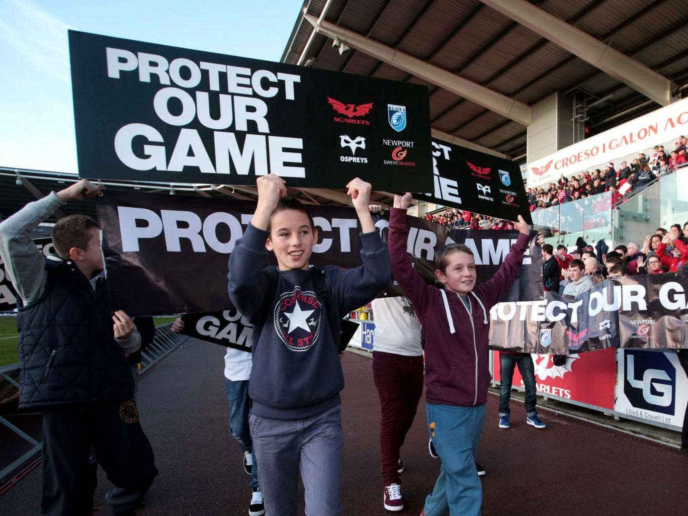 Fans protest before kick off of the game between Scarlets and Ospreys. The four Welsh regional teams have confirmed that they would not sign an extension to their participation agreement with the national governing body