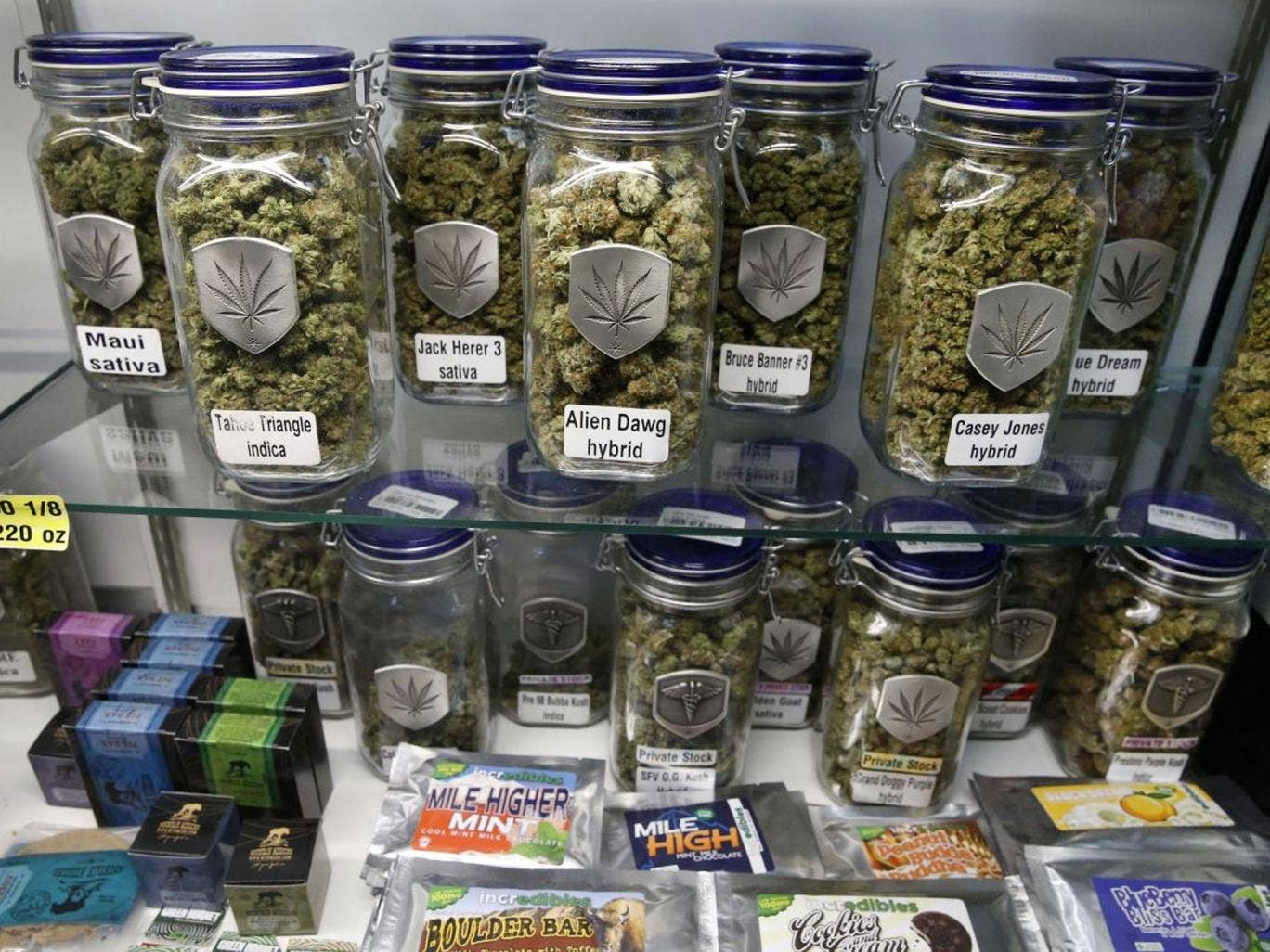 In this Dec. 27, 2013 photo, marijuana and cannabis-infused products are displayed for sale at Medicine Man marijuana dispensary, which is to open as a recreational retail outlet at the start of 2014, in Denver. Colorado is making final preparations for m