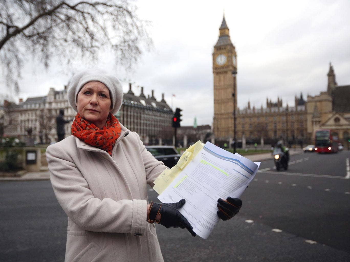 Julie Bailey, of the campaign group 'Cure the NHS', whose mother Bella, 86, died whilst she was a patient at Stafford General Hospital, poses outside the Houses of Parliament with a copy of the report of the Mid Staffordshire NHS Trust Foundation Public